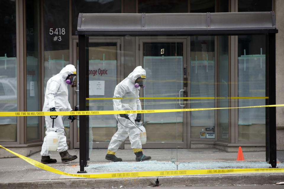 <p>Hazmat workers work around the scene at Yonge St. on April 24, 2018 in Toronto. Cole Burston/Getty Images </p>