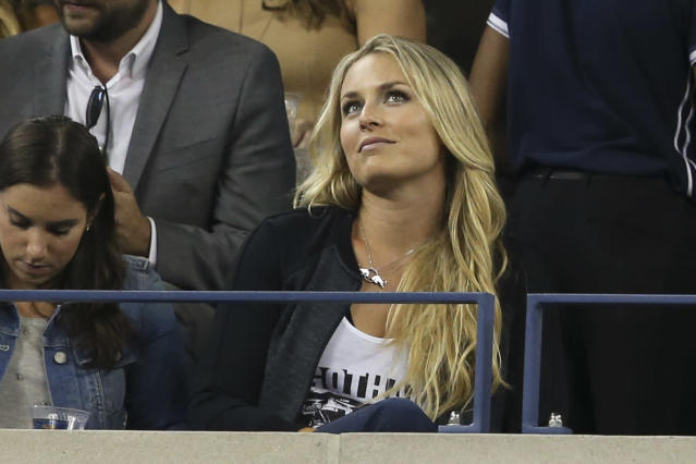 Skier Lindsey Vonn attends the quarterfinal match between Roger Federer, of Switzerland, and Gael Monfils, of France, at the U.S. Open tennis tournament, Thursday, Sept. 4, 2014, in New York. (AP Photo/John Minchillo)