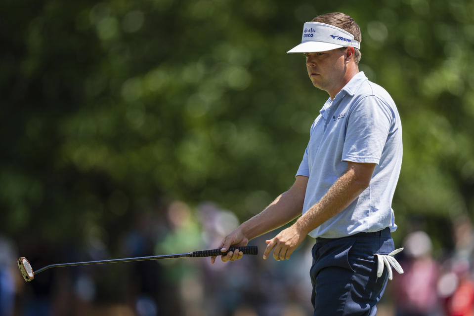 Keith Mitchell reacts after a missed putt on the sixth hole during the fourth round of the Wells Fargo Championship golf tournament at Quail Hollow on Sunday, May 9, 2021, in Charlotte, N.C. (AP Photo/Jacob Kupferman)