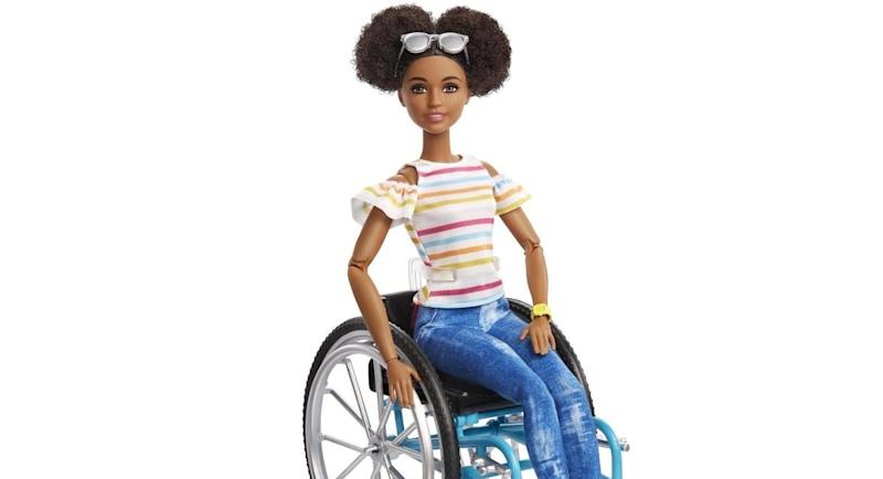 Mattel has created a new black Barbie who wears her hair natural and uses a wheelchair [Image: Mattel]