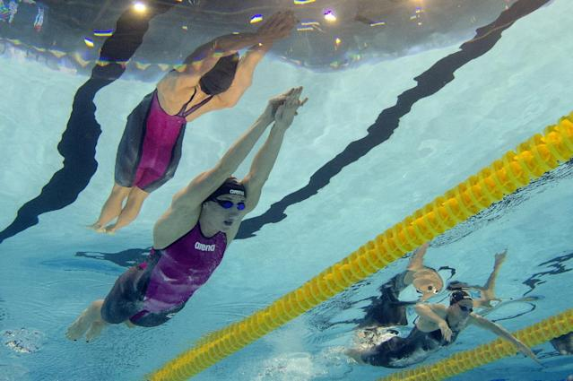 This picture taken with an underwater camera shows Hungary's Katinka Hosszu (L) and her compatriot Evelyn Verraszto competing in the heats of the women's 200m medley event at the 32nd LEN European Swimming Championships on August 20, 2014 in Berlin (AFP Photo/Damien Meyer)