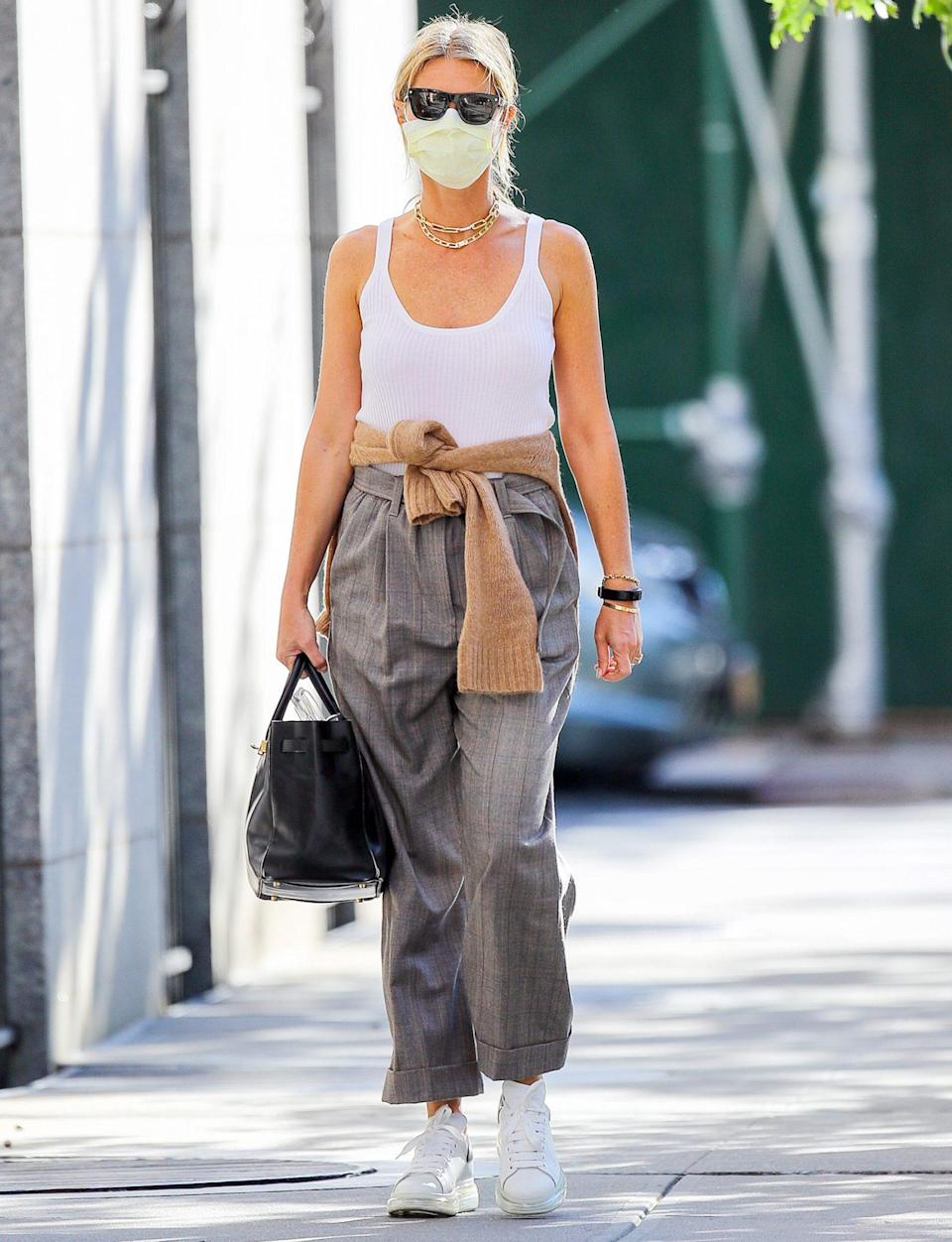 <p>Gwyneth Paltrow wraps a sweater around her waist while out and about in N.Y.C. on Thursday. </p>