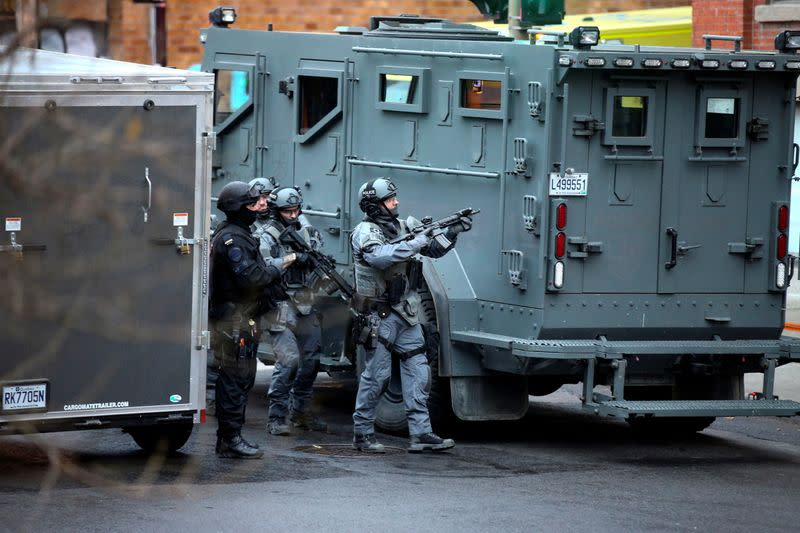 Police prepare to enter the offices of gaming software developer Ubisoft in Montreal