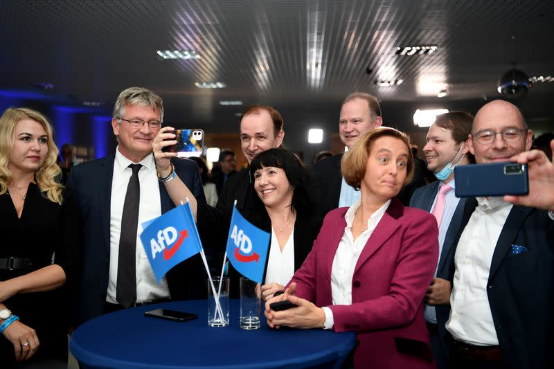 Far right AfD party supporters react after first exit polls for the German general election in Berlin