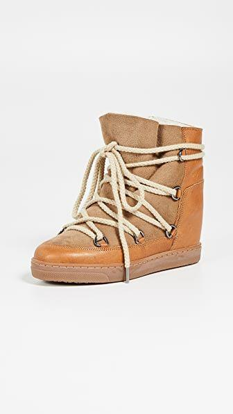 """<p><strong>Isabel Marant</strong></p><p>shopbop.com</p><p><strong>$680.00</strong></p><p><a href=""""https://go.redirectingat.com?id=74968X1596630&url=https%3A%2F%2Fwww.shopbop.com%2Fnowles-boots-isabel-marant%2Fvp%2Fv%3D1%2F1503602062.htm&sref=https%3A%2F%2Fwww.harpersbazaar.com%2Ffashion%2Ftrends%2Fg3124%2Fbest-snow-boots%2F"""" rel=""""nofollow noopener"""" target=""""_blank"""" data-ylk=""""slk:Shop Now"""" class=""""link rapid-noclick-resp"""">Shop Now</a></p><p>If cozy and functional got together to make a baby, this is it. The Isabel Marant Nowles boots just makes walking around during winter look (and feel) so good!</p>"""