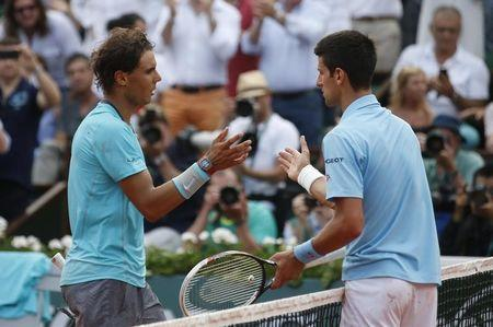 Rafael Nadal of Spain shakes hands with Novak Djokovic of Serbia after winning their men's singles final match at the French Open Tennis tournament at the Roland Garros stadium in Paris