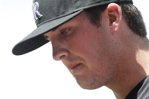 Colorado Rockies starting pitcher Drew Pomeranz (13) walks onto the field before facing the Los Angeles Dodgers before the first inning of a baseball game, Wednesday, May 2, 2012, in Denver. (AP Photo/Barry Gutierrez)