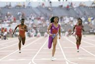 """<p>""""Flo Jo,"""" as she's known, accepted three medals at the 1988 olympics. She wore electrifying one-legged jumpsuits during the US Track and Field Olympic Trials in Indianapolis, Indiana - and <a href=""""https://www.popsugar.com/celebrity/Beyoncé-JAY-Z-Flo-Jo-Tommie-Smith-Halloween-Costumes-45444511"""" class=""""link rapid-noclick-resp"""" rel=""""nofollow noopener"""" target=""""_blank"""" data-ylk=""""slk:Beyoncé even recreated her magenta look for Halloween in 2018"""">Beyoncé even recreated her magenta look for Halloween in 2018</a>.</p>"""