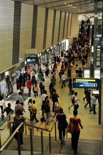 Commuters on the SMRT circle line train arrive at Bishan station interchange during a service disruption in Singapore