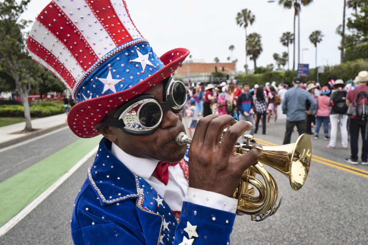 A trumpeter who went only by the name Lenny plays a tune during the Santa Monica Fourth of July parade Thursday, July 4, 2019 in Santa Monica, Calif. (Photo: Richard Vogel/AP)