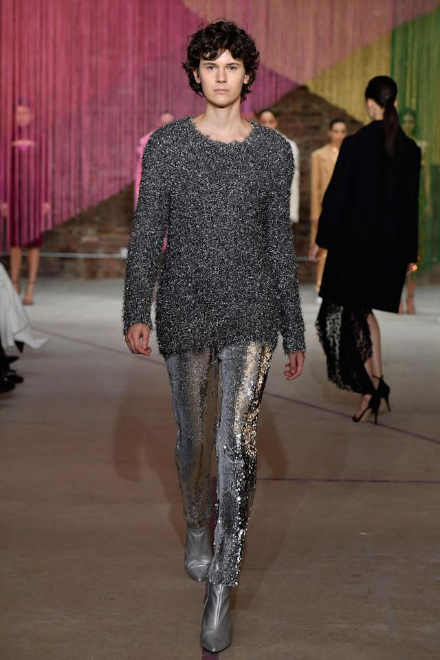 <p>Male model wears a silvery shimmery top, sequin trousers and silver booties at the Milly Fall/Winter 2018 show. (Photo: Courtesy of Greg Kessler) </p>