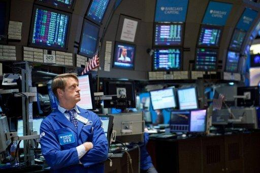 A trader works on the floor of the New York Stock Exchange on March 6