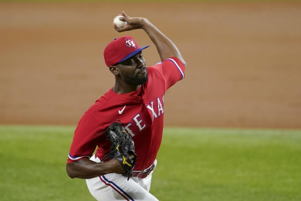 Texas Rangers starting pitcher Taylor Hearn throws to a Chicago White Sox batter during the third inning of a baseball game in Arlington, Texas, Friday, Sept. 17, 2021. (AP Photo/Tony Gutierrez)