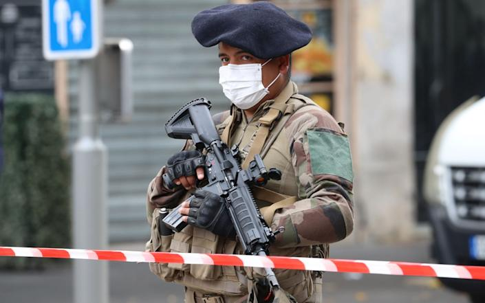 A French soldier secures the site of a knife attack in Nice - VALERY HACHE/AFP