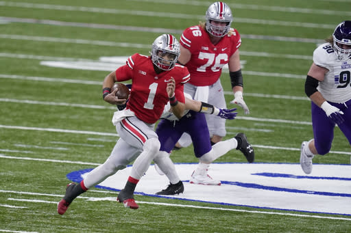 Ohio State quarterback Justin Fields (1) runs with the ball during the first half of the Big Ten championship NCAA college football game against Northwestern, Saturday, Dec. 19, 2020, in Indianapolis. (AP Photo/Darron Cummings)