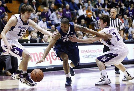 Penn State guard D.J. Newbill (2) splits the defense of Northwestern's Kale Abrahamson (13) and Dave Sobolewski (3) during the first half of an NCAA college basketball game, Thursday, March 7, 2013, in Evanston, Ill. (AP Photo/Charles Rex Arbogast)