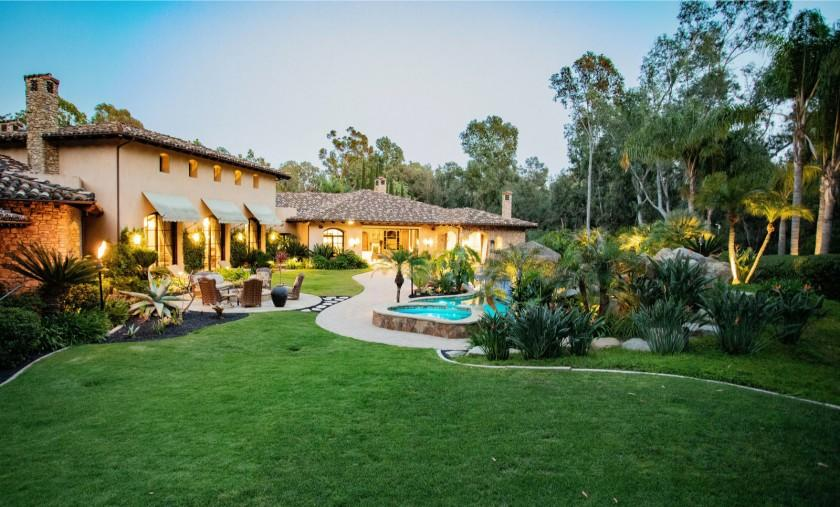 "Spanning two acres in San Diego County's Fairbanks Ranch neighborhood, the property holds a 10,000-square-foot home with a resort-style backyard. <span class=""copyright"">(Ryane Nicole Photos)</span>"