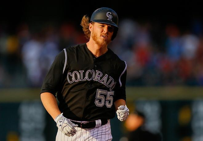 Rockies pitcher Jon Gray circles the bases after hitting a mammoth 467-foot home run against the Reds. (Getty Images)