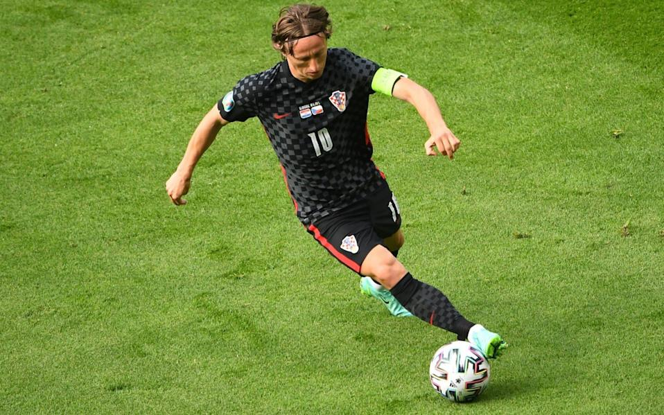 For editorial news reporting purposes only. Images must appear as still images and must not emulate match action video footage. Photographs published in online publications shall have an interval of at least 20 seconds between the posting.) Mandatory Credit: Photo by Andy Buchanan/POOL/EPA-EFE/Shutterstock (12116100cv) Luka Modric of Croatia in action during the UEFA EURO 2020 group D preliminary round soccer match between Croatia and the Czech Republic in Glasgow, Britain, 18 June 2021. Group D Croatia vs Czech Republic, Glasgow, United Kingdom - Andy Buchanan/POOL/EPA-EFE/Shutterstock