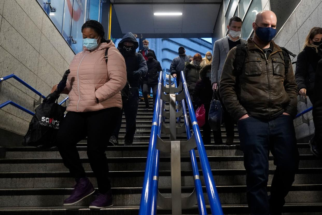 "Commuters wearing masks because of the Covid-19 pandemic are seen at London's Victoria Station during the morning rush hour on December 21, 2020 after London was placed under stringent Tier 4 coronavirus restrictions as cases of the virus surge due to a new more infectious strain. - The British prime minister was to chair a crisis meeting on December 21 as a growing number of countries blocked flights from Britain over a new highly infectious coronavirus strain the UK said was ""out of control"". (Photo by Niklas HALLE'N / AFP) (Photo by NIKLAS HALLE'N/AFP via Getty Images)"