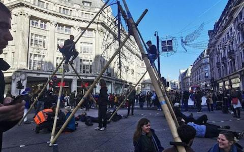 Extinction Rebellion block Oxford Circus in central London with giant bamboo structure - Credit: Sam Povey