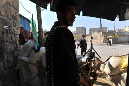 Syrian rebels man a checkpoint in the northern city of Aleppo. Rebels accused strongman Bashar al-Assad on Tuesday of moving chemical weapons to Syria's borders, a day after his beleaguered regime said it would use its stockpiles if attacked