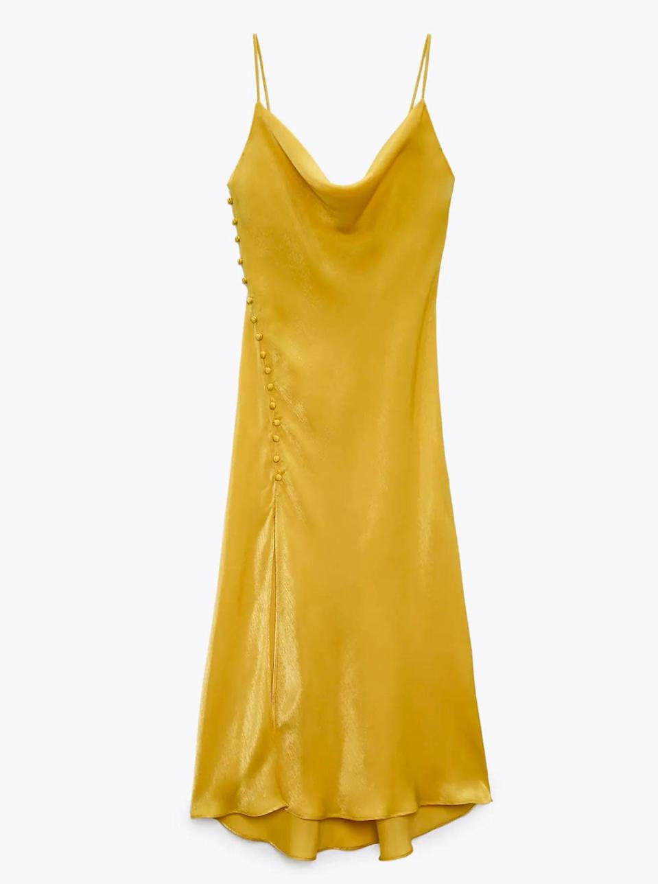 """Count on being the belle of the ball (after the bride, of course) in this satin slip dress with vintage-inspired buttons. $40, Zara. <a href=""""https://www.zara.com/us/en/satin-lingerie-style-dress-p02085762.html?"""" rel=""""nofollow noopener"""" target=""""_blank"""" data-ylk=""""slk:Get it now!"""" class=""""link rapid-noclick-resp"""">Get it now!</a>"""
