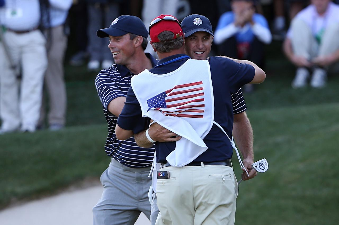 MEDINAH, IL - SEPTEMBER 29:  Dustin Johnson of the USA celebrates his birdie putt on the 17th green with Matt Kuchar and caddie Lance Bennett during day two of the Afternoon Four-Ball Matches for The 39th Ryder Cup at Medinah Country Club on September 29, 2012 in Medinah, Illinois.  (Photo by Ross Kinnaird/Getty Images)