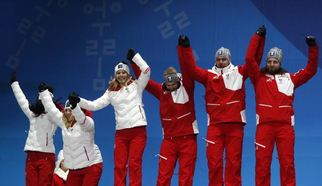 Medals Ceremony - Alpine Skiing - Pyeongchang 2018 Winter Olympics - Team Event - Medals Plaza - Pyeongchang, South Korea - February 24, 2018 - Silver medalist Austria's team on the podium. REUTERS/Jorge Silva