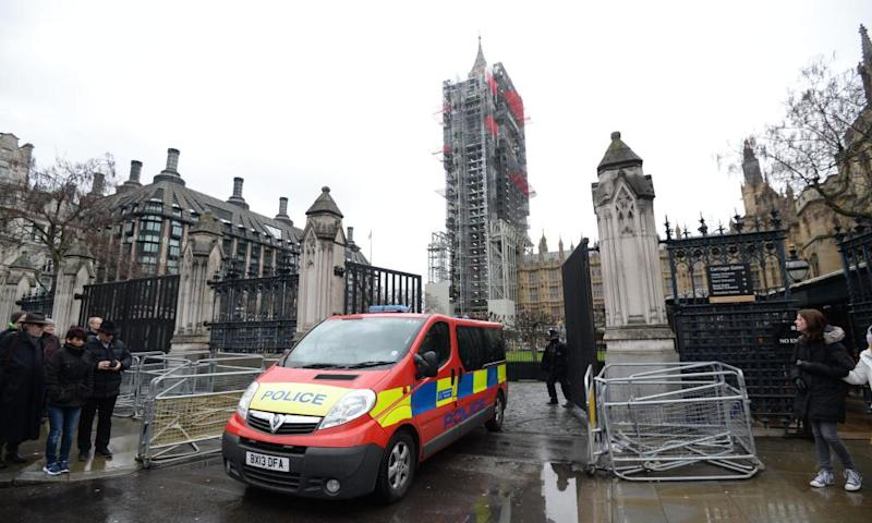 A police vehicle leaves the Palace of Westminster