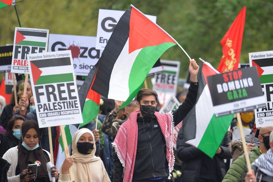 <p>Demonstrators walk through Hyde Park during Saturday's protest</p> (PA)