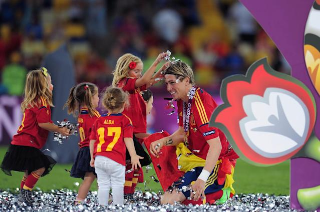 KIEV, UKRAINE - JULY 01: The players' children play in the confetti with Fernando Torres during the UEFA EURO 2012 final match between Spain and Italy at the Olympic Stadium on July 1, 2012 in Kiev, Ukraine. (Photo by Shaun Botterill/Getty Images)