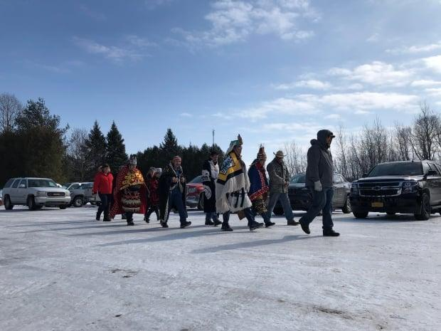 A delegation of Wet'suwet'en hereditary chiefs walks toward the Longhouse to meet with members of the Kahnawake branch of the Mohawk Nation in February 2020.