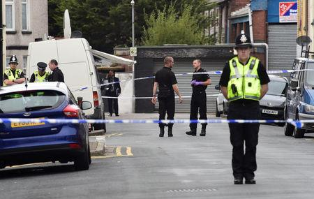 Officers stand behind police cordon after three men were arrested in connection with an explosion on the London Underground, in Newport, Wales, Britain, September 20, 2017. REUTERS/Rebecca Naden