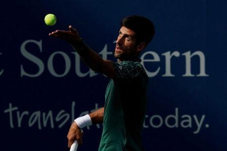 Aug 17, 2018; Mason, OH, USA; Novak Djokovic (SRB) serves against Milos Raonic (CAN) in the Western and Southern tennis open at Lindner Family Tennis Center. Mandatory Credit: Aaron Doster-USA TODAY Sports