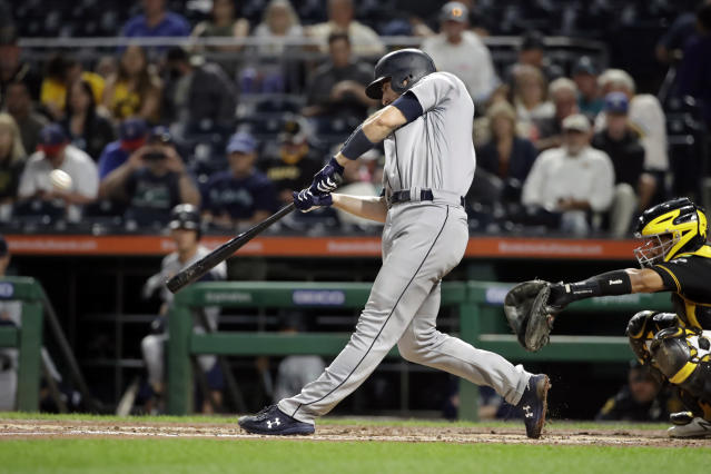 Seattle Mariners' Tom Murphy hits a solo home run off Pittsburgh Pirates starting pitcher Dario Agrazal during the fourth inning of a baseball game in Pittsburgh, Wednesday, Sept. 18, 2019. (AP Photo/Gene J. Puskar)