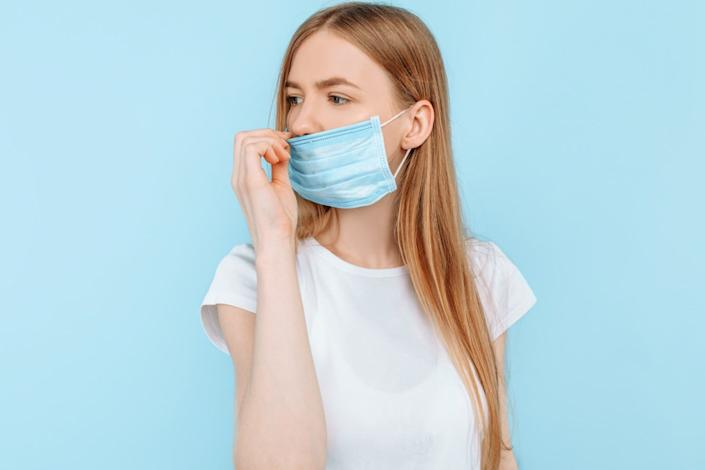 wears a hygiene mask to prevent infection, airborne respiratory disease