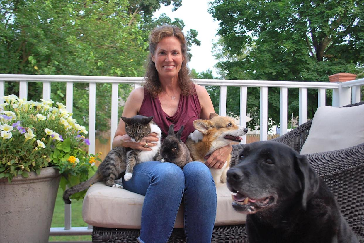 Ashley Collins with her cat, Sugar, her rabbit, Cocoa, and her two dogs, Charlie and Hank. (Photo: Courtesy of Ashley Collins)