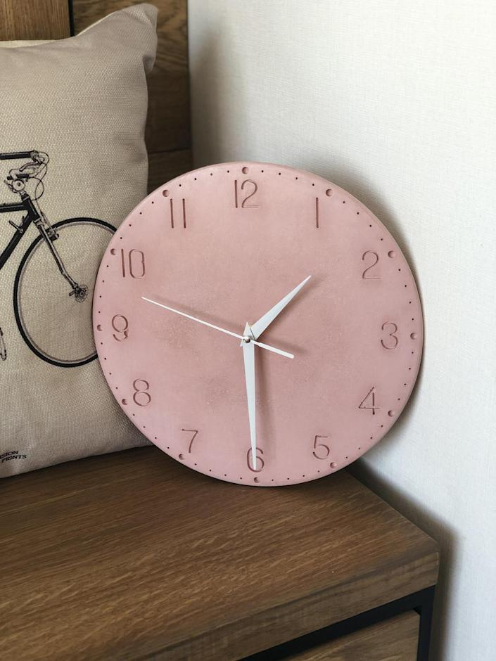 """Cement gives this round wall clock a neutral, matte finish that easily blends into surrounding decor. You can choose between six colors and gold, white, or black hands. It measures 11 inches in diameter. $41, Etsy. <a href=""""https://www.etsy.com/listing/675411335/modern-concrete-wall-clock-gray-concrete"""" rel=""""nofollow noopener"""" target=""""_blank"""" data-ylk=""""slk:Get it now!"""" class=""""link rapid-noclick-resp"""">Get it now!</a>"""