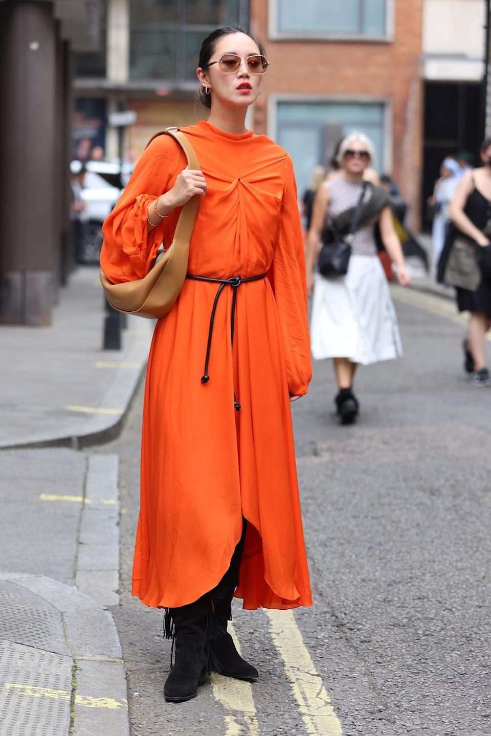 """This bold orange dress really soaks up the last of the summer sun.<span class=""""copyright"""">Photo Courtesy of Neil Mockford/Getty Images.</span>"""
