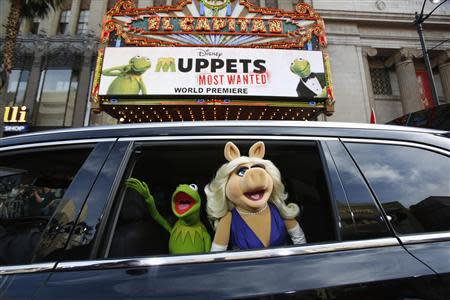 """The characters of Kermit and Miss Piggy arrive at the premiere of """"Muppets Most Wanted"""" in Hollywood"""