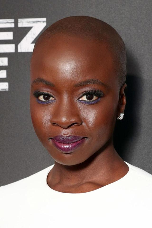 <p>Bald and beautiful! Gurira, who plays Tupac's mother Afeni in the film <em>All Eyez On Me</em>, took our breath away at the Westwood, Calif. premiere with her flawless complexion, fluttery lashes, navy blue eyeliner, and violet lip color. (Photo: Todd Williamson/Getty Images for Codeblack Films) </p>