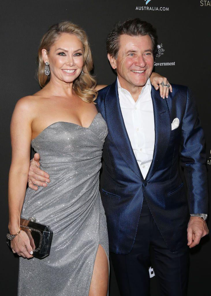 """<p>Another <em>DWTS </em>team who fell in love while competing for the mirrorball trophy? Kym Johnson and Robert Herjavec. It all started when the <em>Shark Tank </em>star was paired with pro dancer Kym on the show in 2015. After being eliminated in week 8, the couple continued to see each other and <a href=""""https://people.com/celebrity/dwts-kym-johnson-and-robert-herjavec-get-married/"""" rel=""""nofollow noopener"""" target=""""_blank"""" data-ylk=""""slk:tied the knot in July 2016"""" class=""""link rapid-noclick-resp"""">tied the knot in July 2016</a>. In 2018, they welcomed twins Hudson and Haven. </p>"""