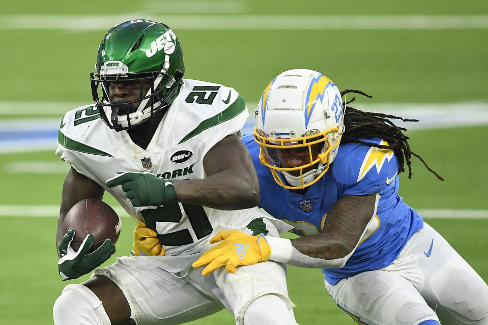 INGLEWOOD, CALIFORNIA - NOVEMBER 22: Frank Gore #21 of the New York Jets is tackled by Rayshawn Jenkins #23 of the Los Angeles Chargers during the second half at SoFi Stadium on November 22, 2020 in Inglewood, California. (Photo by Kevork Djansezian/Getty Images)