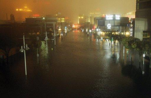 A flooded street is seen at nightfall during rains from Hurricane Sandy in Atlantic City, New Jersey. Sandy made landfall over Southern New Jersey today