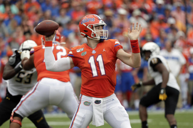 Florida quarterback Kyle Trask (11) throws a pass during the first half of an NCAA college football game against Towson, Saturday, Sept. 28, 2019, in Gainesville, Fla. (AP Photo/John Raoux)