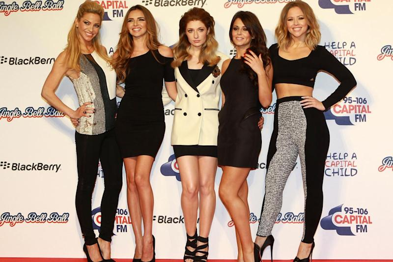 Supportive: Cheryl with Sarah Harding, Nadine Coyle, Nicola Roberts and Kimberley Walsh in Girls Aloud (Fred Duval/Getty)