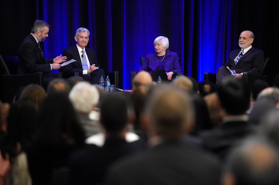 From left, The New York Times' Neil Irwin, Federal Reserve Chairman Jerome Powell, and former Federal Reserve Chairs Janet Yellen and Ben Bernanke participate in a conference, Friday, Jan. 4, 2019, in Atlanta. Powell said the central bank intends to be flexible going forward in determining when to hike its key policy rate. He also said that the Fed could alter its approach to trimming its huge balance sheet if it determines such a change is needed. (AP Photo/Annie Rice)