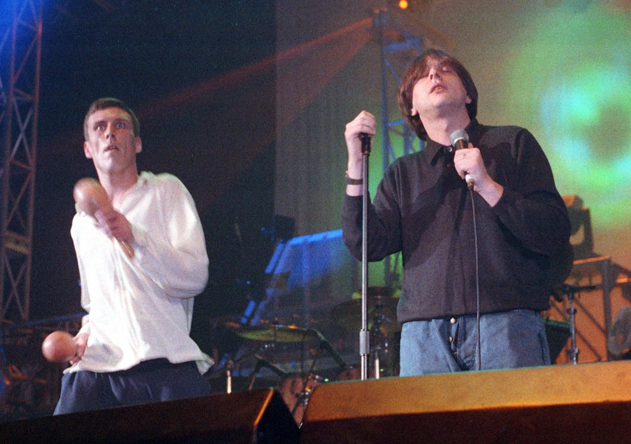 Bez and Shaun Ryder of the Happy Mondays performing on stage at Astoria Theatre, London, 14 March 1989. (Photo by Ian Dickson/Redferns)