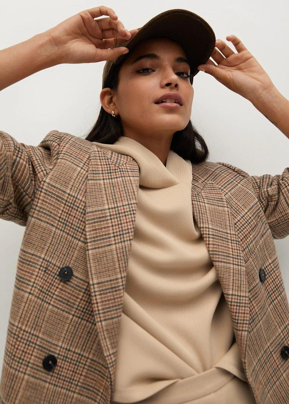<p>This <span>Mango Wrap Check Blazer</span> ($130) is as effortlessly cool as it gets.</p>